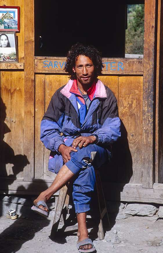 Tibetan-looking lodge owner, Pisang, Manang Valley, Around Annapurna Trek