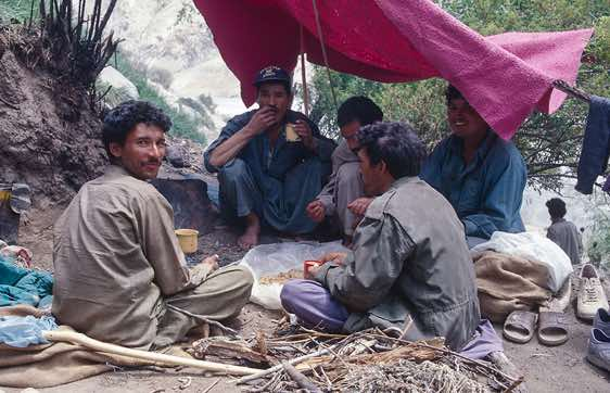 A group of porters is having a meal, Camp Paiju, Karakoram Mountains