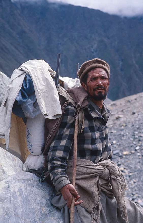 Porter with his heavy payload, Baltoro Glacier, Karakoram Mountains
