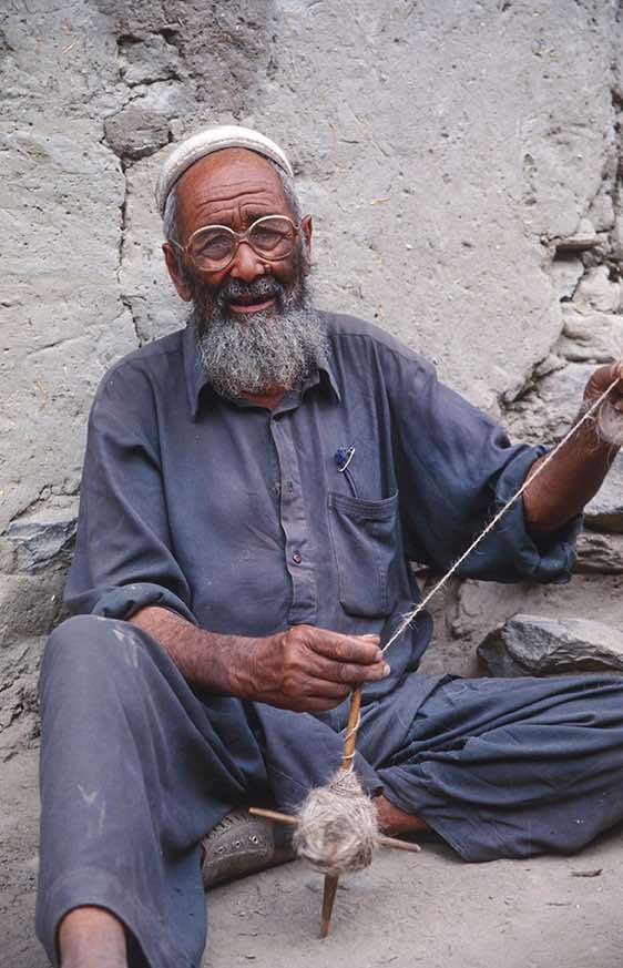 Man spinning wool, Hushe, Karakoram Mountains