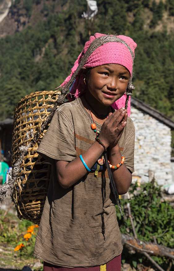 Girl with a bamboo basket (doko), Buri Gandaki Valley, Around Manaslu Trek, Nepal Himalaya