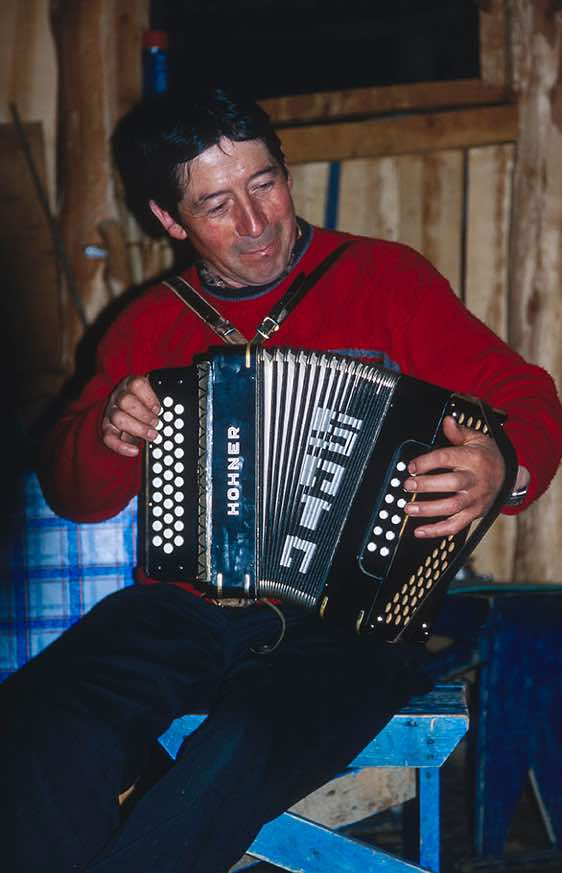 Luis Soto playing accordion, Fundo San Lorenzo, Chile