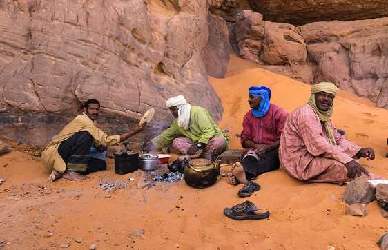 Tuareg baking bread, Tadrart region, Tassili n ́Ajjer National Park, Sahara, North Africa