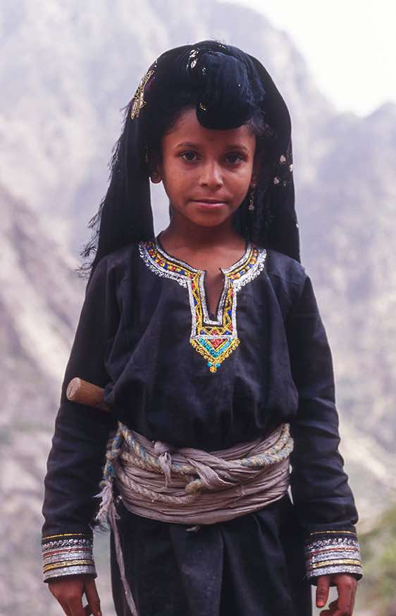 Girl in traditional dress, Jebel Rugab, Bura mountains
